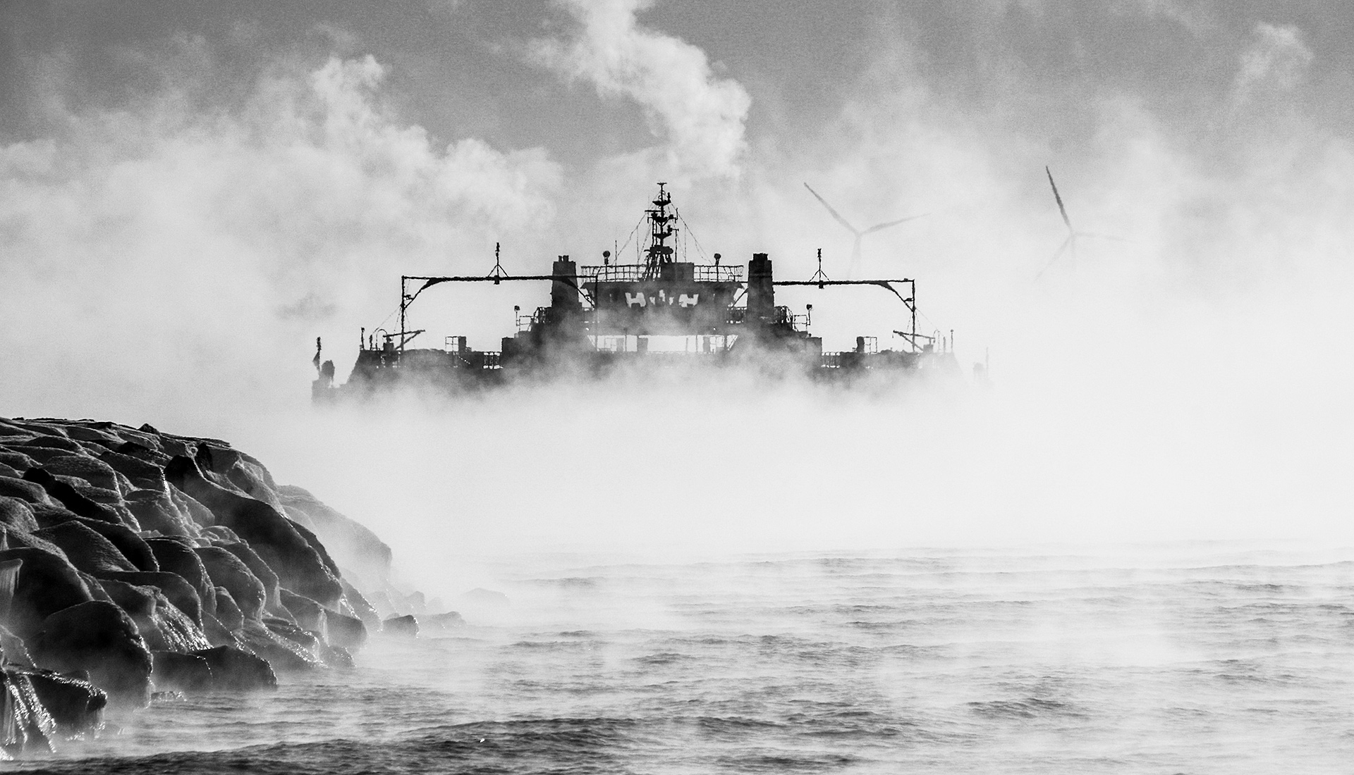 an image of the wolfe island ferry surrounded by fog