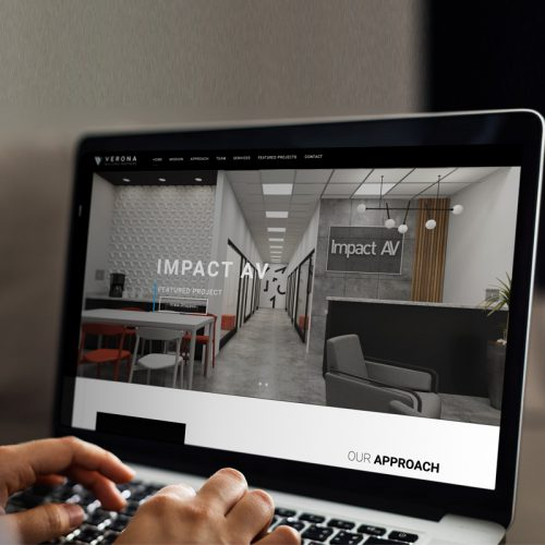 a laptop is shown displaying the Verona building partners website
